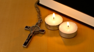 cross with two candles